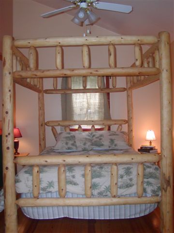 The star of the Captain s Quarters is a four poster queen size log bed   Enjoy any season with ceilng fan  zoned air conditioning  and heat. The Boonedocks Marina